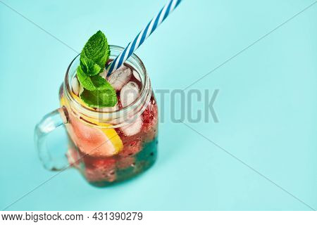 Cold Refreshing Cocktail With Ice, Mint And Copy Space On Blue Background