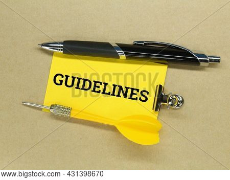 Pens, Arrows, Colored Paper With The Word Guidelines