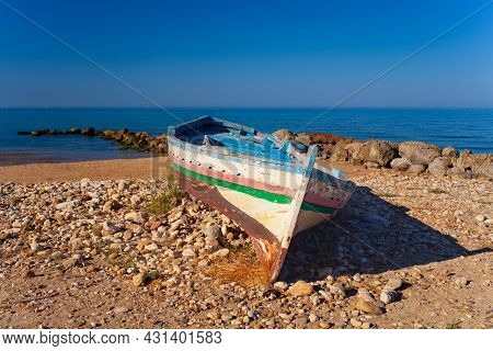 A Broken Migrant Boat Stranded On The Beach Of The Agrigento Coast