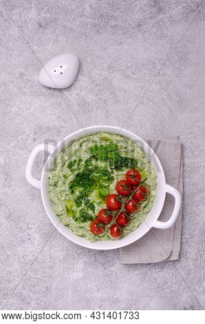 Mashed Potatoes With Tomatoes And Green Sauce On A Stone Background. Top View. Selective Focus.