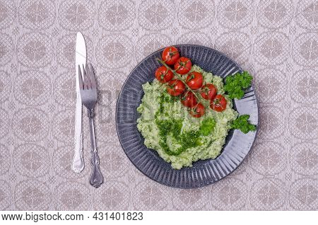 Mashed Potatoes With Tomatoes And Green Sauce On A Textile Background. Top View. Selective Focus.