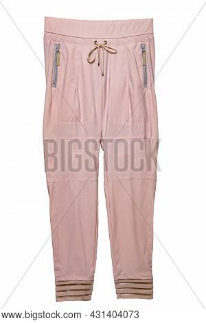 Woman Casual Trousers. Elegant Sporty Female Light Pink Trousers Flat Lays Isolated On A White Backg