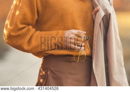 Closeup Details Fashionable Woman 30-35 Years Old, Dressed In An Orange Knitted Sweater, Yellow Glas