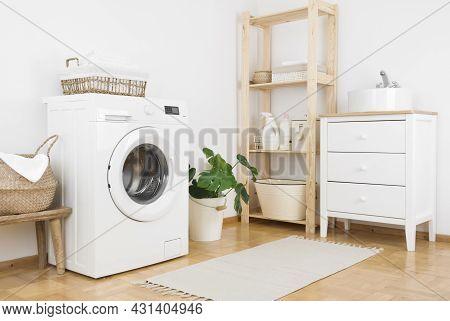 Bathroom Laundry Corner Interior With Washing Machine, Storage And Sink