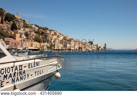 Symi, Greece - Jun 03, 2021. The Harbour Of Symi Town With The Districts Of Chorio And Gialos Is One
