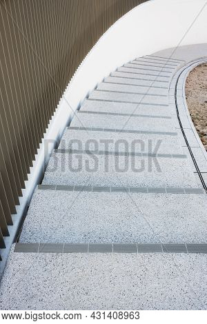 Closeup Of Spiral Stairway. Building Abstract Background