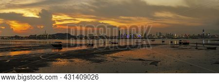 Idyllic Landscape Of Lau Fau Shan In Hong Kong And Skyline Of Shenzhen City In China Under Sunset