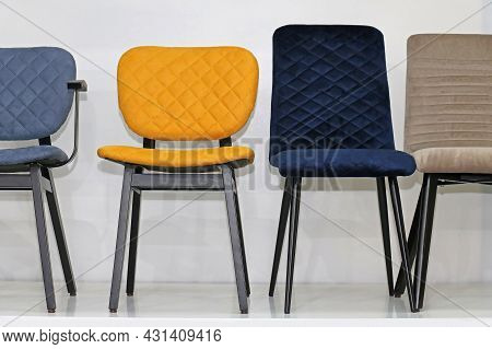 Colorful Modern Chairs In A Row Covered With Textile Upholstery