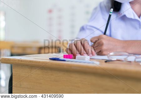 Girl Student In Exam Test School, Side View Of High School Or University Holding Writing Document Pa