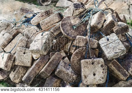 A Pile Of Floats For Commercial Fishing Nets. Lots Of Old Floats Outdoors. Floats Are Square, Round,