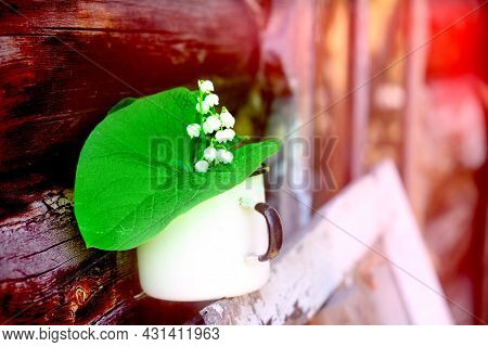 Blurred Rustic Still Life, Summer Flowers In  Enamel Cup,  Old Wooden Country House Background