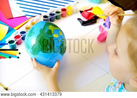 Child Drawing Pattern Of Flower And Plants On The Balloon. Earth Day. Arts  Crafts Concept. Art Lear