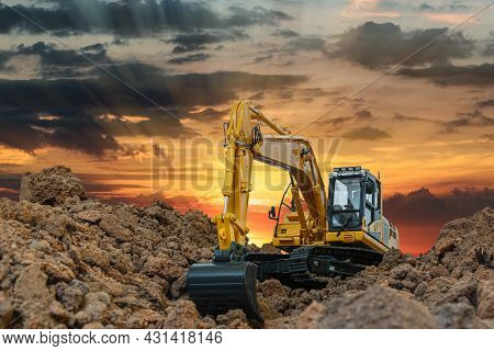 Crawler Excavator Digging The Soil In The Construction Site On  Sunbeam  Background