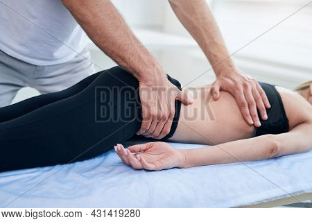 Male Physiotherapist Doing Professional Manual Therapy Session In Medical Office
