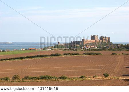 Bamburgh Castle In Summer Sun On Coast Of Northumberland