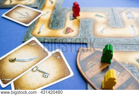 Moscow, Russia, July 2019: A Board Pirate Game Cartagena With Cards, Wooden Game Chips - Pirate Figu