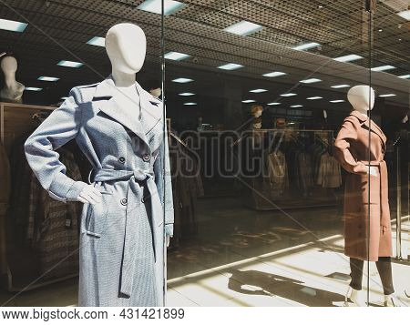 Autumn Collection Of Coats In Clothing Store, Female Mannequins In Shop Window