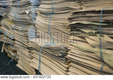 Neat Stack Of Old Newspapers With Close Up Detail Of The Corner Of The Pile