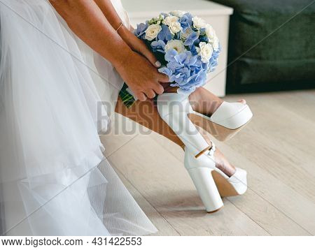 Bride With Bouquet In Hands And  White Sandals