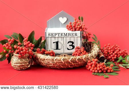 Calendar For September 13 : The Name Of The Month In English, Cubes With The Number 13 On A Decorati