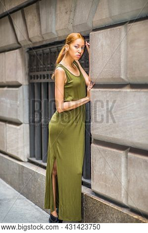 Girl Waiting For You. Dressing In A Green, Long Maxi Tank Dress,  A Young Black Woman Is Standing By