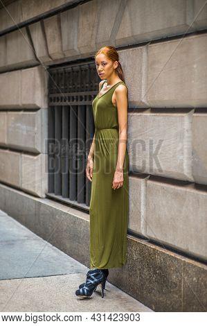 Woman Relaxing On Street. Dressing In A Green, Long Maxi Tank Dress,  Black Dress Sandals, A Young B