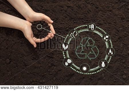 Hands With Soil On The Background Of The Earth, Bio Icon, The Concept Of Biodegradable Materials, Wa