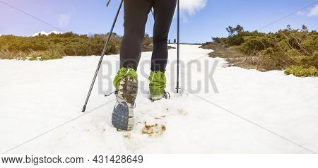 Young Girl Is Engaged In Trail Running, Runs To The Top Of A Snowy Mountain With Trekking Poles, Sho