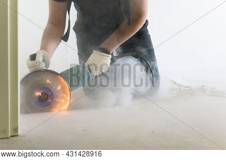 Cutting Concrete Floor Screed Bolarka Man In Construction Combenizon And Work Gloves. Power Tools. F
