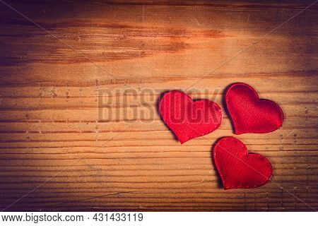 Vignetting Photo Of Red Hearts On The Wooden Planks Background Closeup