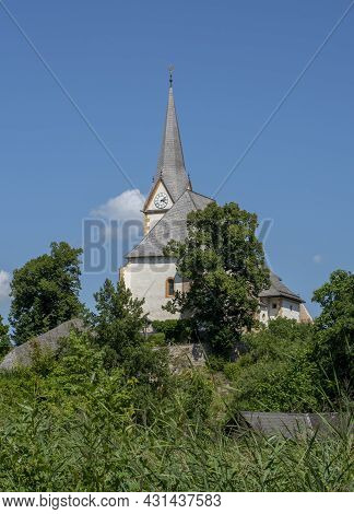 The Church Of Maria Worth At Lake Worthersee In Carinthia, Austria In Summer.