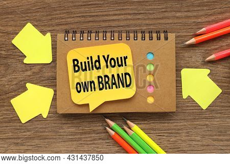 Build Your Own Brand, Notepad Sticker On Wood Background