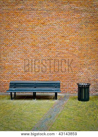 Bench And Brick Wall