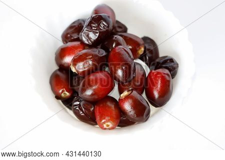 Beautiful Tasty Fresh Dark Red Dates Fruit Or Date Palm In White Background. Selective Focus