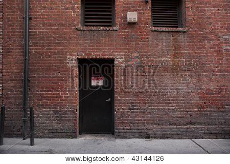 Alley Entrance Backside Of Brick Building