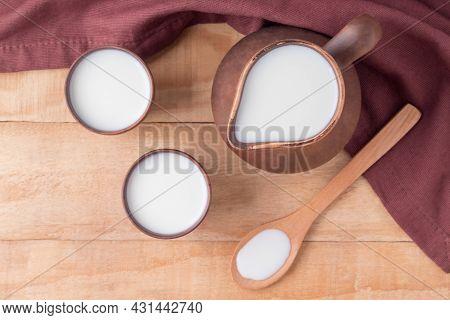 Flat Lay Composition With Organic Kefir, Yogurt Or Ayran On Wooden Table. Fermented Dairy Milk Produ