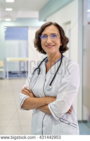Smiling Older Senior Female Doctor Medical Nurse Wearing Glasses And White Coat With Stethoscope Aro