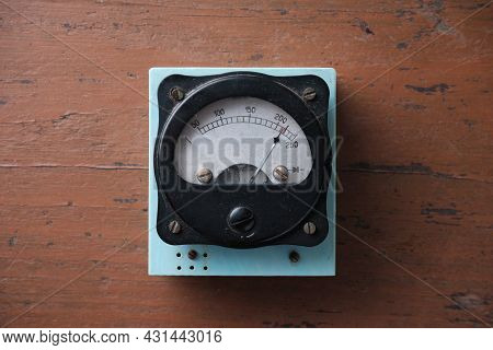 Old Analog Voltmeter With A Metal Arrow. Measurement Of Voltage In The Electrical Network.