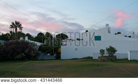 Traditional Architecture At Algarve, Portugal. White Family Houses. Beautiful Sky During Sunset. Eur