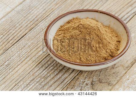 raw organic dried camu camu fruit powder (Myciara Dubia) in a small ceramic bowl - rainforest superfruit from Peru rich in vitamin C