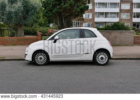 30 August 2021 - Essex, Uk: White Fiat 500 Parked In Road In Front Of Apartments