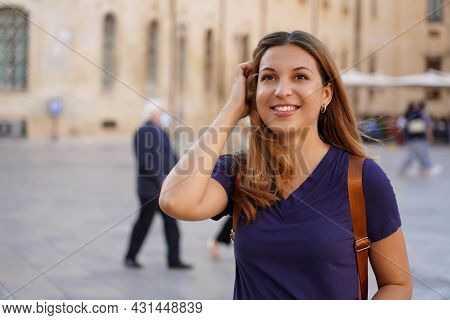 Close Up Portrait Of Delightful Cheerful Latin Woman With Toothy Smile Having A Walk In A Foreign Ci