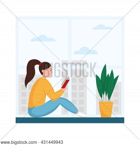 Young Woman Reading Book On The Windowsill