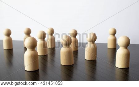 The Child Was Lost In The Crowd. A Crowd Of Wooden Figures Of People Surround A Lost Child. Lost, Pa