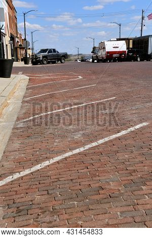 The Main Street Of A Small Town Is Paved With Cobblestones.