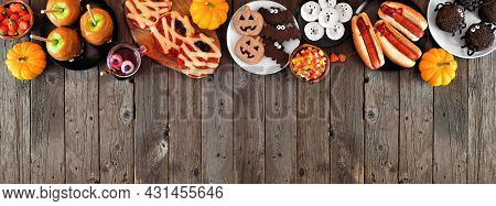 Halloween Party Food Top Border Over A Rustic Wood Banner Background With Copy Space. Above View. Sp