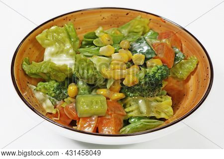 Fresh Mixed Vegetable Compound Salad With Broccoli, Baby Corn, Cucumber Carrot And Lettuce
