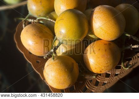 Yellow Passion Marquisa Fruits. The Bali Fruits, Indonesia. Asia Fruit In A Bowl On The Table Backgr
