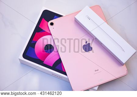 Bangkok, Thailand - August 21, 2021: New Apple Ipad Rose Gold Color, Rear View Logo Apple Launch Tab