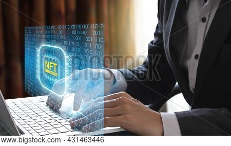 Business Man Using Laptop Computer Invest And Pay For Unique Collectibles In Games Or Art, Nft Non F